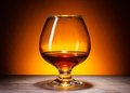 Glass with cognac in fancy reflection Stock Photo