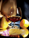 Glass of cognac with lemon and pear Royalty Free Stock Photo