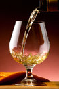 Glass of cognac set in cellar Stock Photography