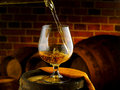 Glass of cognac set in cellar Royalty Free Stock Photo