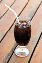 Glass of cola with ice cube for refresh Stock Photography