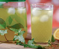 Glass of cold green tea with ice cubes on wooden table Royalty Free Stock Photography