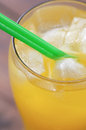 Glass of cold orange drink