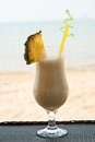 Glass cold smoothie against sea Royalty Free Stock Photo