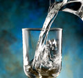 Glass of cold water jug poured into the Royalty Free Stock Photo