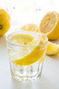 Glass of cold water with lemon slices Royalty Free Stock Image