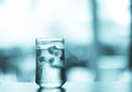 Glass of Cool fresh drink with ice cube on the  table Royalty Free Stock Photo