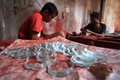 Glass craft worker making from in solo central java indonesia Stock Images