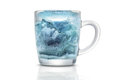 Glass cup with a blue ice Royalty Free Stock Photo