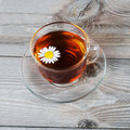 Glass cup with a camomile tea Royalty Free Stock Photo