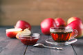 Glass cup of herbal tea with raspberry jam Royalty Free Stock Photo