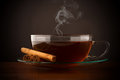 Glass cup of hot tea with cinnamon Royalty Free Stock Photo