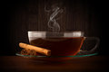 Glass cup of hot tea with cinnamon Royalty Free Stock Images