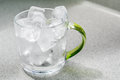 Glass cup with ice cubes Royalty Free Stock Photo