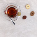 Glass cup of tea with cookies on the table marble Royalty Free Stock Images