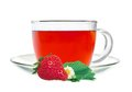 Glass cup tea with strawberry and green leaves isolated on white Royalty Free Stock Photo