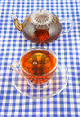 Glass cup of tea and teapot Royalty Free Stock Images