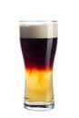 Glass of dark beer on white background