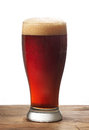 Glass of dark beer on wooden table Royalty Free Stock Photo