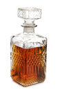 Glass decanter of whiskey on white background Stock Image