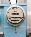 Glass dome watt hour electric utility meters dock outside old analog style Royalty Free Stock Photography