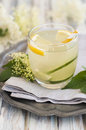 A glass of elderflower cordial with lime and lemon Stock Photography