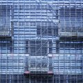 Glass Facade Building Construction industry with scaffold Architecture detail Royalty Free Stock Photo