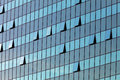 Glass facade with opened windows Royalty Free Stock Photo
