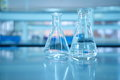 Glass flask in blue science lab Royalty Free Stock Photo