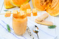 Glass of fresh cantaloupe smoothie  on white wooden boards. Clos Royalty Free Stock Photo