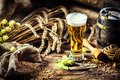 Glass of fresh cold beer in rustic setting. Food and beverage ba