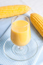 Glass of fresh corn milk with ripe corns Stock Photography