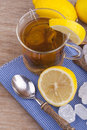 Glass with fresh hot lemon tea Stock Photo