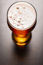 Glass fresh lager beer black table Royalty Free Stock Image
