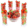 Glass with fresh strawberries  on white. Isolated Royalty Free Stock Images