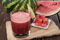 Glass with fresh watermelon juice and pieces of fruit Royalty Free Stock Photos