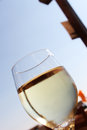 A glass of fresh white wine urban background detailed view taken in very sunny day portrait cut Stock Photo