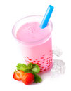 Glass of frothy strawberry bubble tea Stock Images