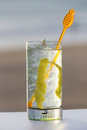 Glass of gin with lime spices on a beach Stock Photography