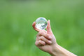 Glass globe in hand Royalty Free Stock Photo