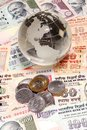 Glass globe on indian currency closeup of Royalty Free Stock Photography