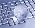 Glass globe on keyboard Royalty Free Stock Photo