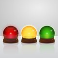 Glass globes traffic light red yellow green Stock Images
