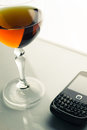 Glass goblet mobile phone wine and Stock Photography