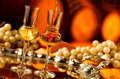 Glass of grappa glasses set in a cellar with barrels reserves Royalty Free Stock Photography