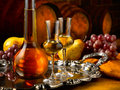 Glass of grappa glasses set in a cellar with barrels reserves Stock Photo