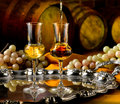 Glass of grappa glasses set in a cellar with barrels reserves Stock Image