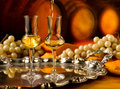 Glass of grappa glasses set in a cellar with barrels reserves Stock Photography