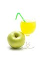 Glass of green apple juice isolated on white background. Royalty Free Stock Photo