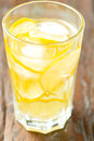 Glass of homemade lemonade vertical on wooden table Royalty Free Stock Image